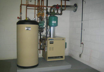 Oil to natural gas conversion boiler system and domestic hot water tank